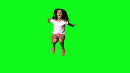 Happy girl jumping on green screen Footage