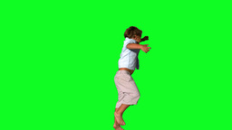 Little boy jumping on green screen Footage