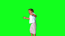 Little boy jumping and shouting on green screen Stock Video Footage
