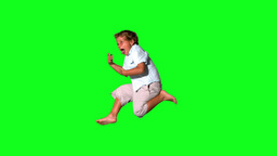 Little boy jumping and shouting on green screen Footage