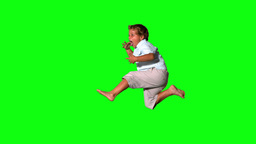 Little boy jumping and shouting on green screen si Footage