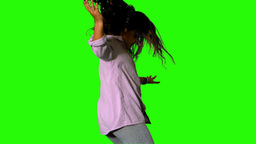 Little girl jumping and turning on green screen Stock Video Footage