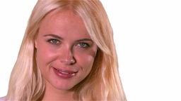 Blonde woman smiling on white background Stock Video Footage