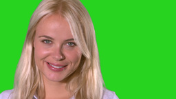 Pretty blonde woman smiling on green screen Footage