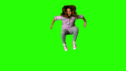 Happy little girl jumping on green screen Footage