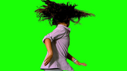 Girl jumping and spinning on green screen Stock Video Footage