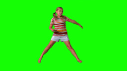 Girl jumping with limbs outstretched on green scre Footage