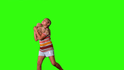 Girl jumping and catching teddy on a green screen Footage