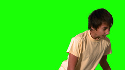 Boy heading a football on green screen Footage