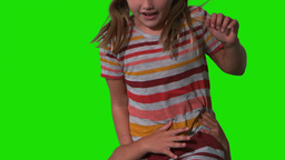 Siblings jumping up and down on green screen Footage