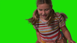 Siblings jumping up and down on green screen Stock Video Footage