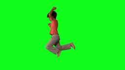 Side view of boy jumping on green screen Footage