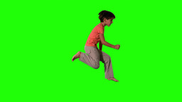 Boy jumping on green screen side view Footage