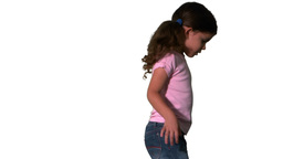 Cute little girl spinning around on white backgrou Stock Video Footage