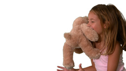 Cute little girl catching teddy bear on white back Stock Video Footage