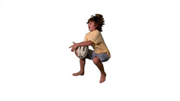 Little boy jumping and catching rugby ball on whit Footage