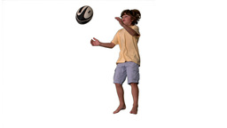 Little boy jumping up and catching rugby ball on w Footage