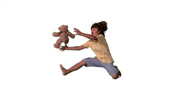 Young boy jumping up and catching teddy bear on a  Footage