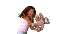 Little girl jumping up and down and turning with t Stock Video Footage