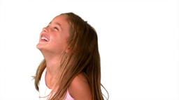 Close up of little girl laughing and turning on white background Footage