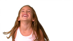 Close up of little girl laughing and turning on wh Stock Video Footage