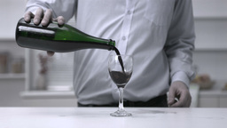 Man pouring wine into a glass Stock Video Footage