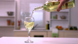 Hand pouring white wine into glass Stock Video Footage
