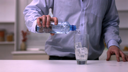 Man pouring water into a glass Footage