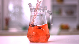 Jug of juice being poured Stock Video Footage