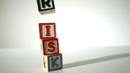 Risk spelled out in blocks falling over Stock Video Footage