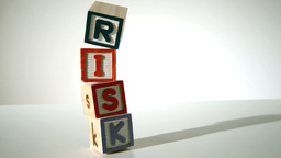 Risk spelled out in blocks falling over Footage