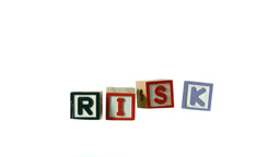 Risk spelled out in letter blocks falling in a row Stock Video Footage