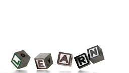 Learn spelled out in letter blocks falling over Footage