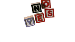 Blocks spelling yes and no falling over on white b Footage