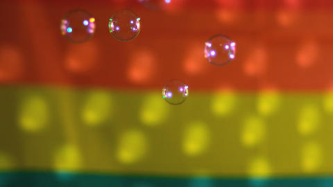 Bubbles floating against rainbow flag Stock Video Footage