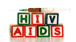Needle falling on blocks spelling AIDS and HIV Stock Video Footage