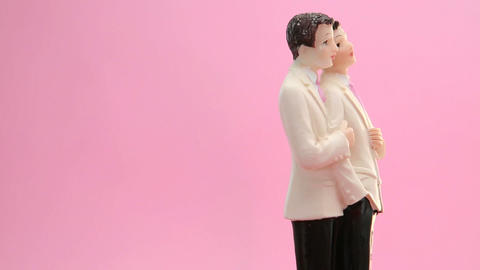 Revolving gay groom cake toppers Stock Video Footage