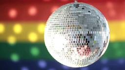 Disco ball spinning against rainbow flag Footage