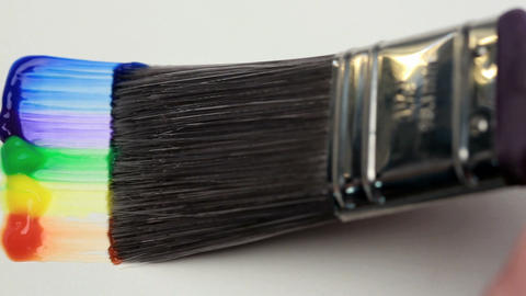 Paintbrush with a rainbow brush stroke Stock Video Footage