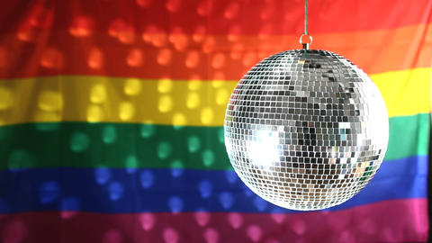 Disco Ball Revolving Against Gay Pride Flag stock footage