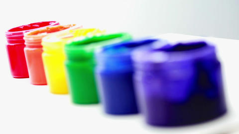 Rainbow paint pots in a row for gay pride Stock Video Footage