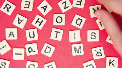 Autism spelled out in letter pieces Stock Video Footage