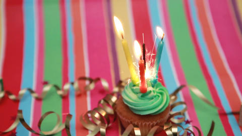 Birthday cupcake with sparkler and candle Live Action