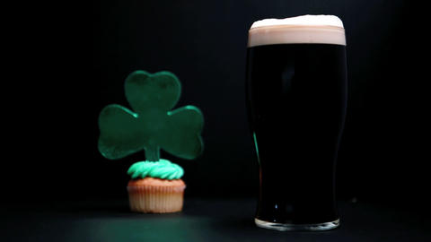 Pint of stout and st patricks day cupcake Footage