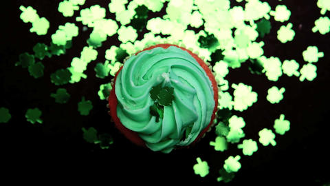 St patricks day cupcake revolving with green shamr Footage