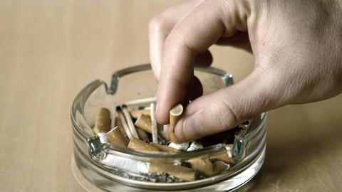 Man Putting Out Cigarette In Ashtray stock footage