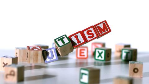 Blocks spelling autism falling Footage