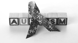 Awareness ribbon falling in front of autism letter Stock Video Footage