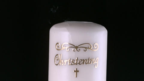 Lit christening candle flickering and going out Stock Video Footage