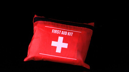 First aid kit falling Stock Video Footage